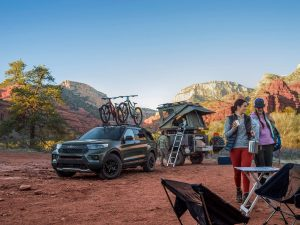 family at a campsite with a 2021 Ford Explorer Timberline