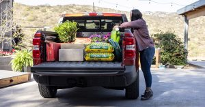 woman loading the back of her 2022 Ford Maverick