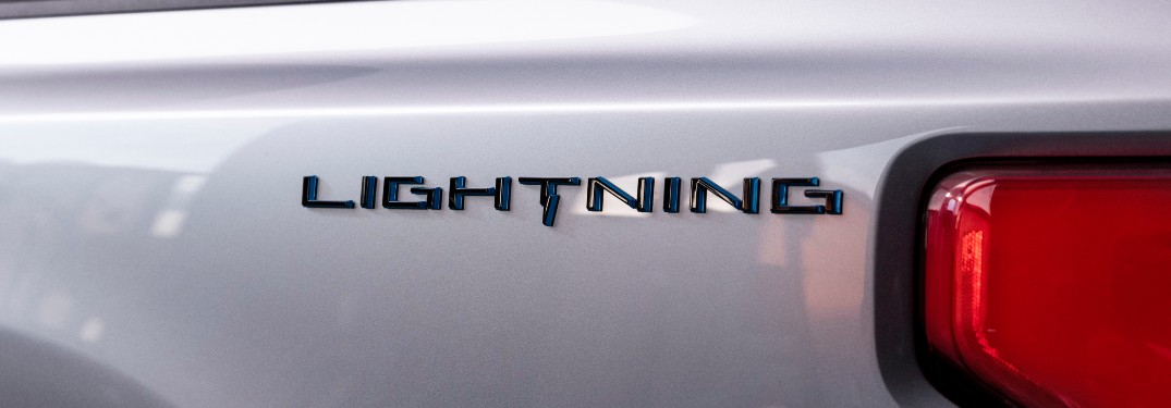 Lightning badge on the side of a silver 2022 Ford F-150 Lightning