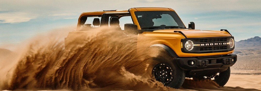 2021 Ford Bronco driving through sand