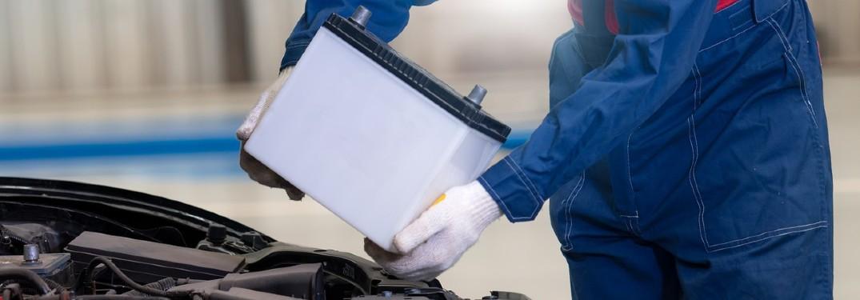 Mechanic installing car battery