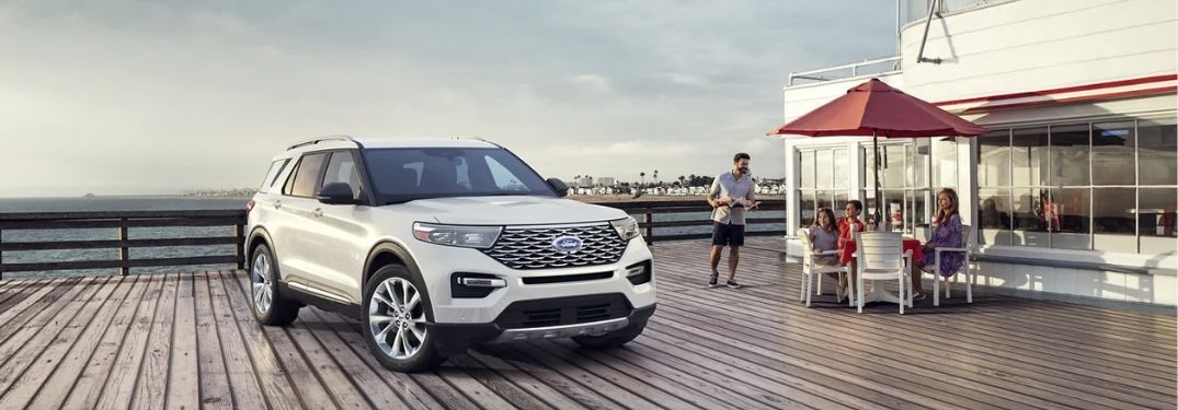 2021 Ford explorer standing besides a shop in the beach