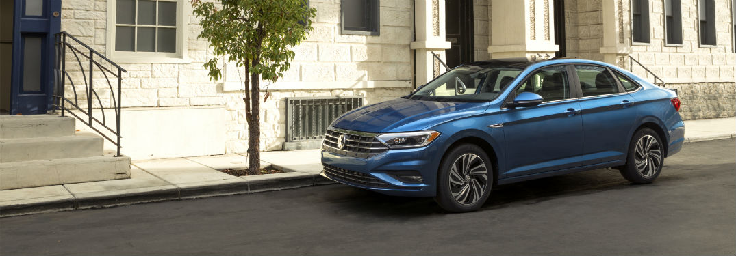 Driver's side exterior view of a blue 2019 VW Jetta