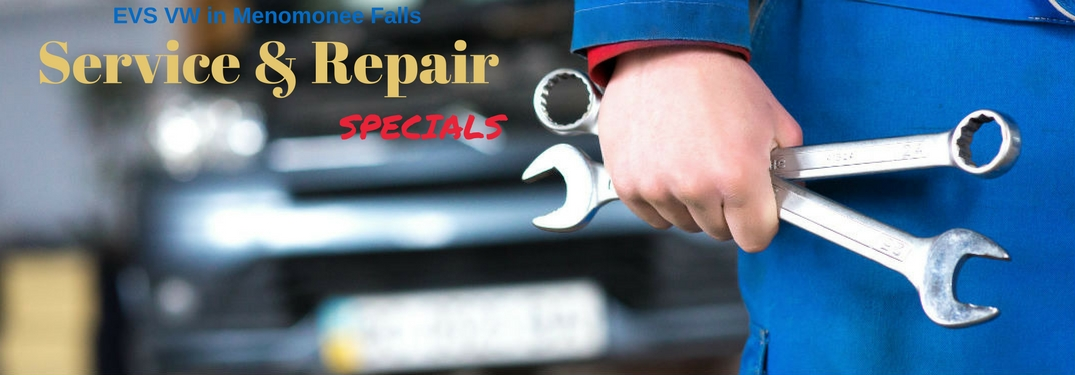 EVS VW Service & Repair Specials, text on an image of a mechanics hand holding wrenches