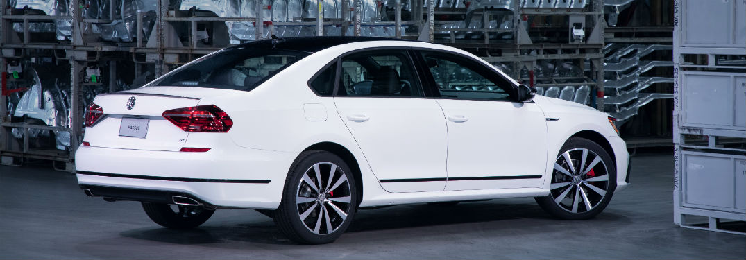Passenger side exterior view of a white 2018 VW Passat