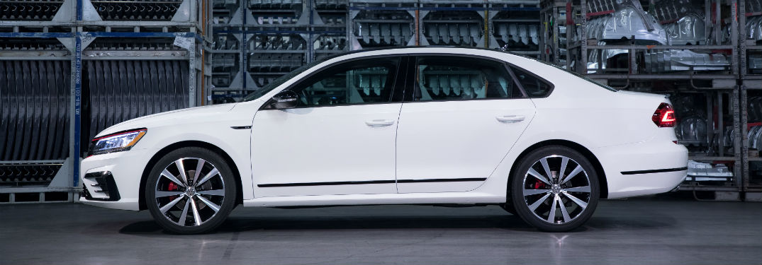 Driver side exterior view of a white 2018 VW Passat