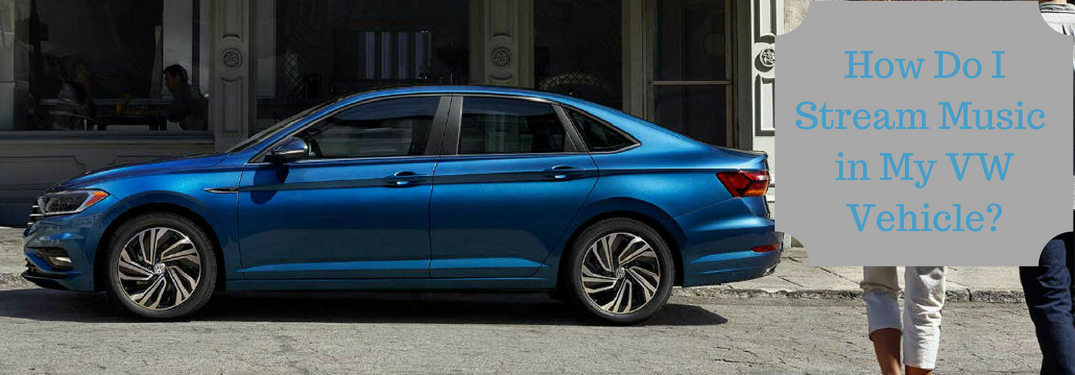 How Do I Stream Music in My VW Vehicle, text on an image of a blue 20190 Volkswagen Jetta