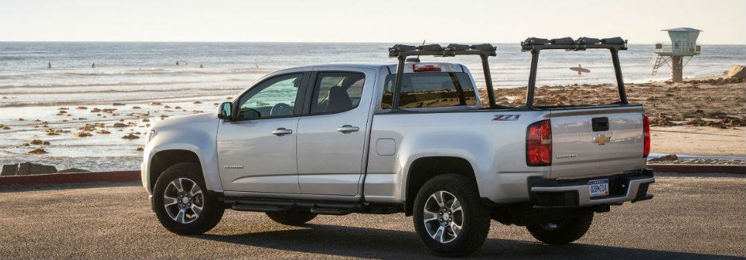 2018 chevrolet colorado in silver shown on edge of beach looking out to water with kayak roof rack attached