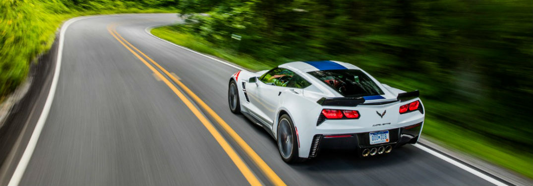 2018 Corvette Grand Sport Shot From Rear Driving Down Forest Road