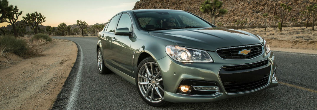 2015 Chevrolet Ss Driving On Road With Detailed Close Up Of Front Grille  And Fascia