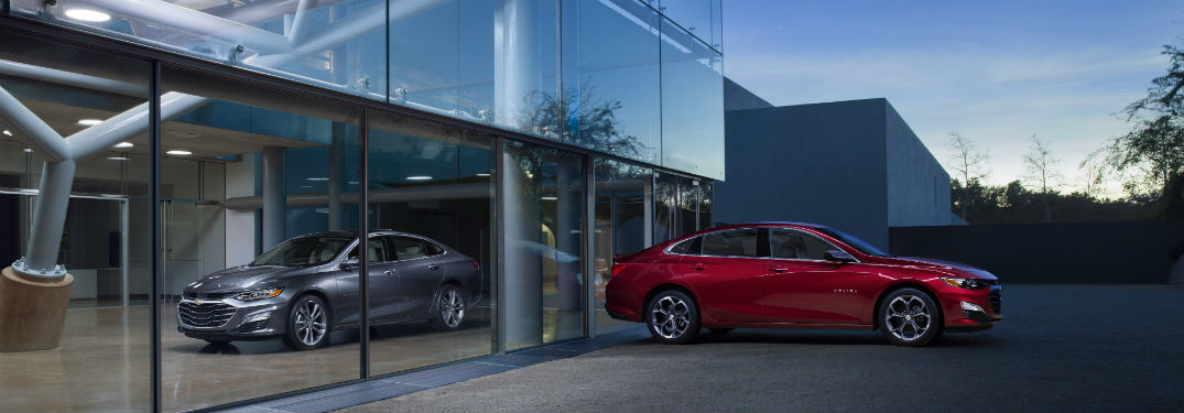 2019 Chevy Malibu parked outside of a showroom