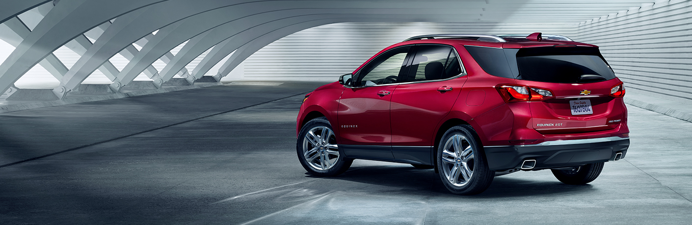 red 2019 chevy equinox in grey room