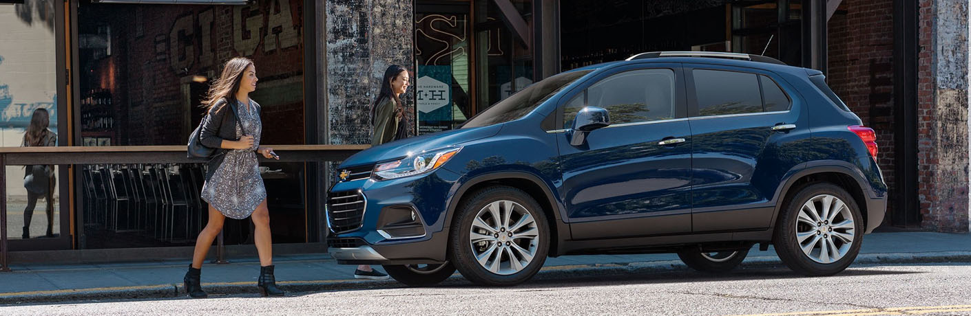 blue 2019 chevy trax parked on city block