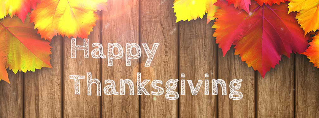 wood sign says Happy Thanksgiving with fall leafs