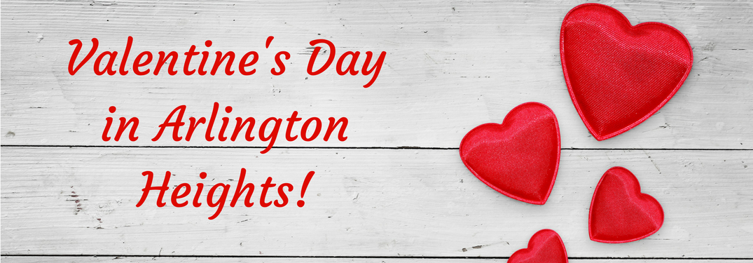 """""""valentine's day in arlington heights"""" red text over white-stained wood with hearts next to it"""