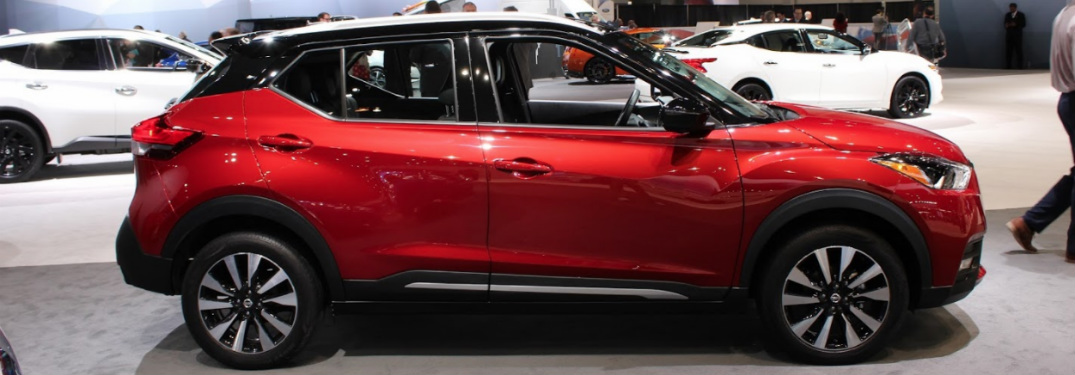 full side view of red and black 2018 nissan kicks