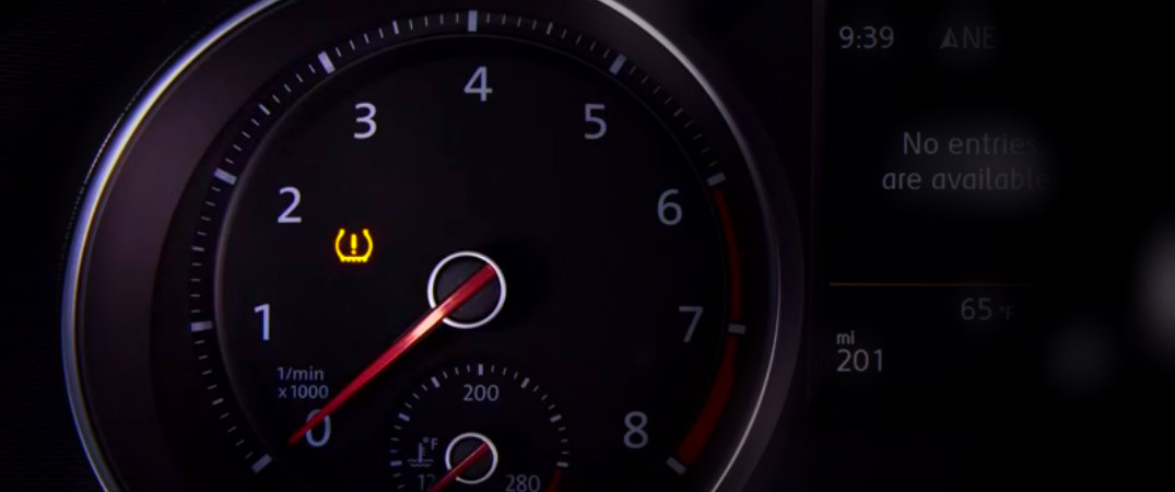 car speedometer with tire pressure light on