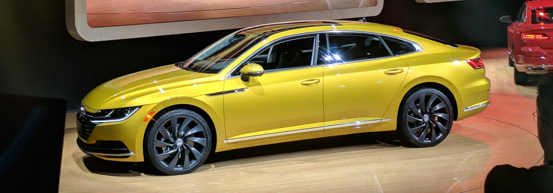 gold-yellow volkswagen arteon