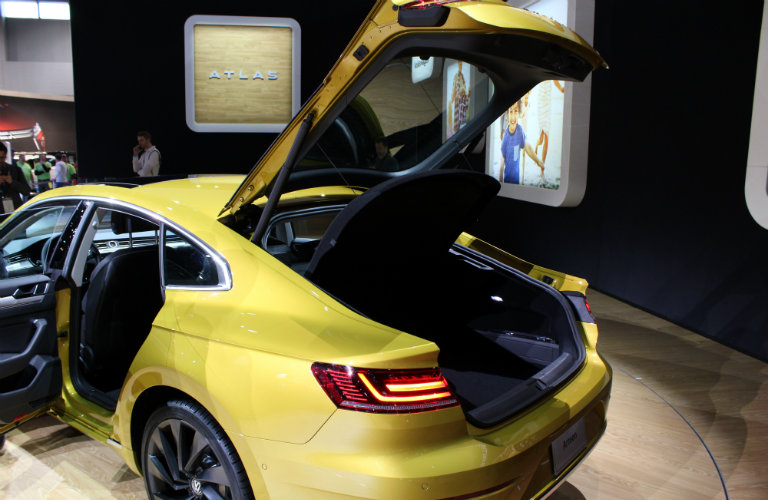 yellow volkswagen arteon trunk open