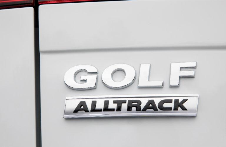 golf alltrack logo on silver surface