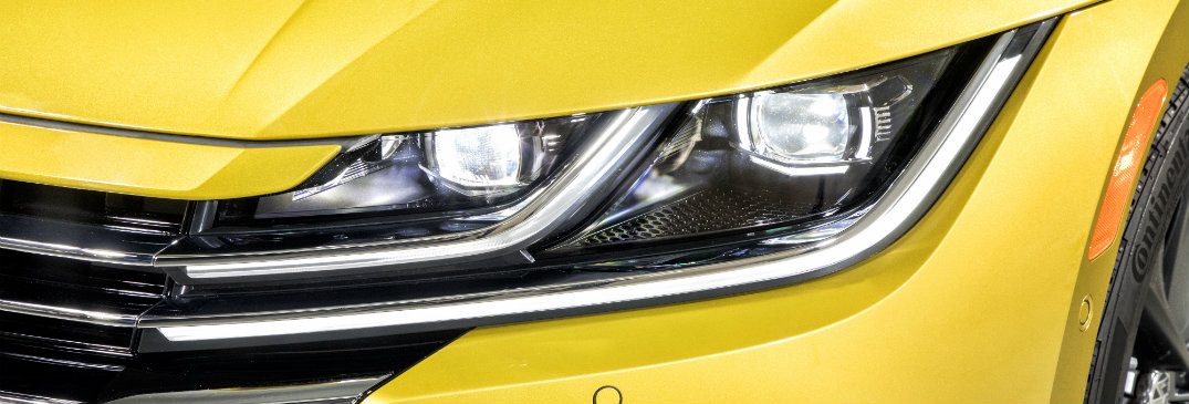 headlight of yellow volkswagen arteon