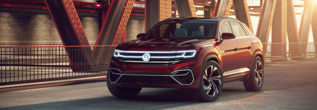 red volkswagen atlas cross sport on bridge