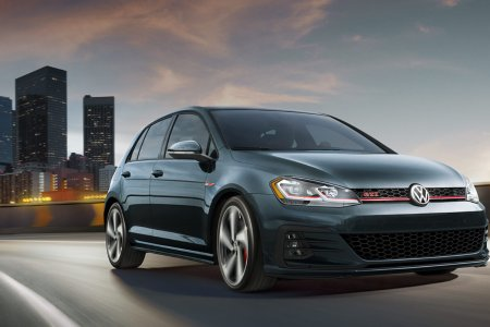 2018 Volkswagen Golf GTI driving out of a city