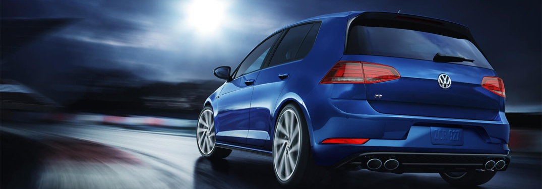 2018 Volkswagen Golf R driving down a dark road