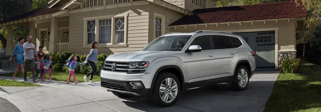 2019 Volkswagen Atlas parked in front of a building