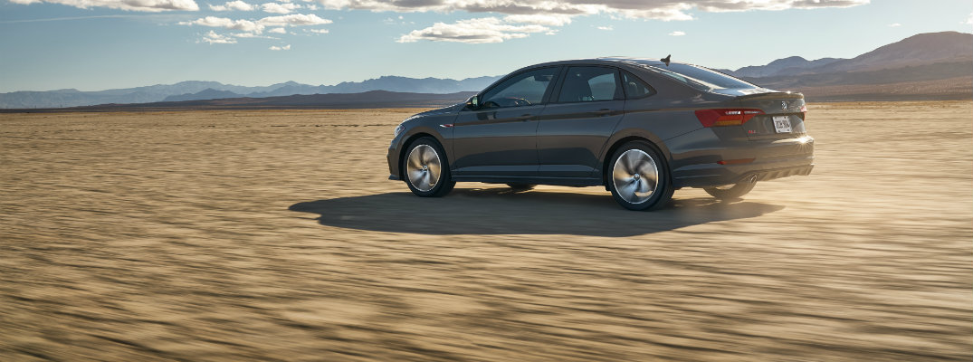 2019 VW Jetta GLI going the distance on a sandy open area