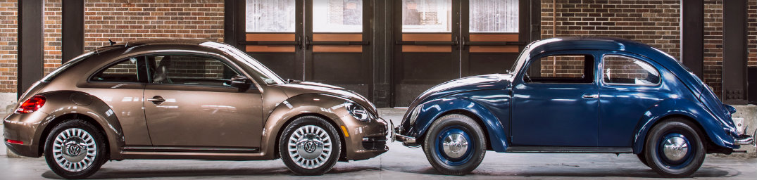 Two VW Beetles facing each other