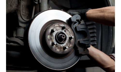 Brake pad being installed on a car