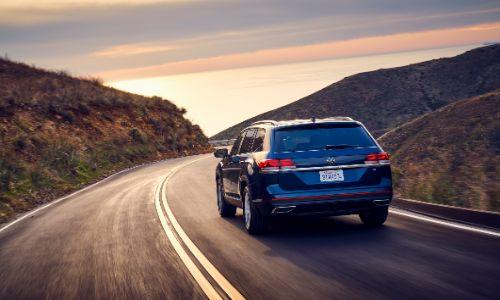 2021 VW Atlas driving towards sunset