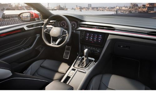 2021 Volkswagen Arteon interior shot of front seating, transmission, steering wheel, and dashboard