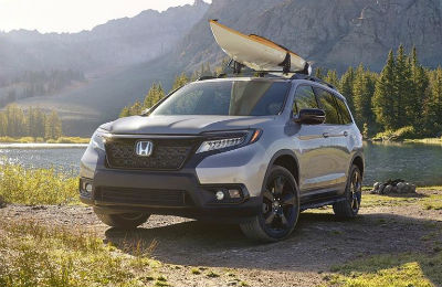 2019 Honda Passport exterior front fascia and drivers side with kayak on top