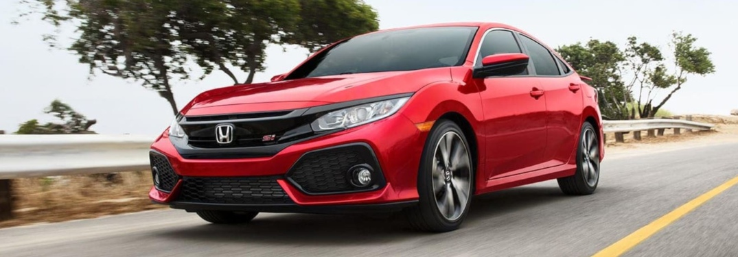 Red 2019 Honda Civic driving on open road