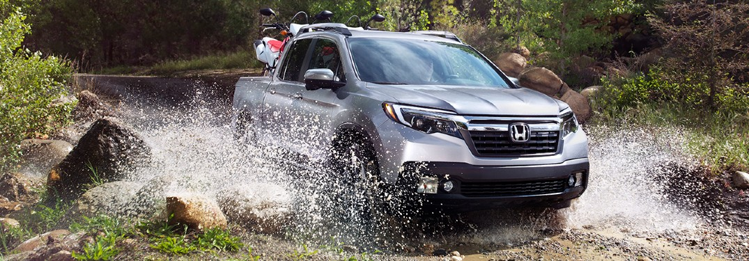 2020 Honda Ridgeline exterior front passenger side driving through water