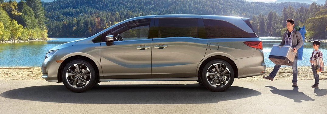 2021 Honda Odyssey exterior drive side parked at beach in forest father and sun walking to tailgate