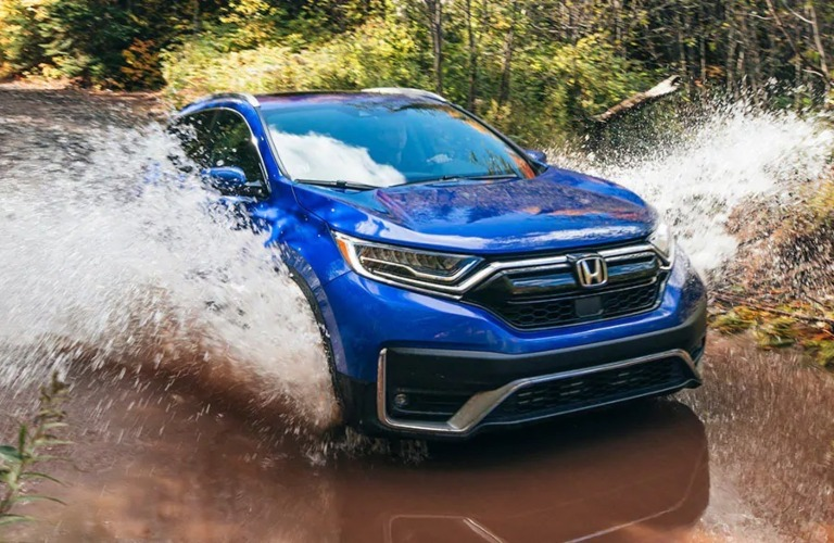 2021 Honda CR-V blue front view driving through water and mud