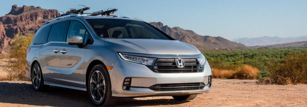 2022 Honda Odyssey parked on a dirt road with hills in the background