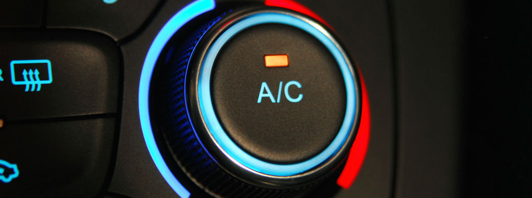 A stock photo of a air conditioner control knob in a car.