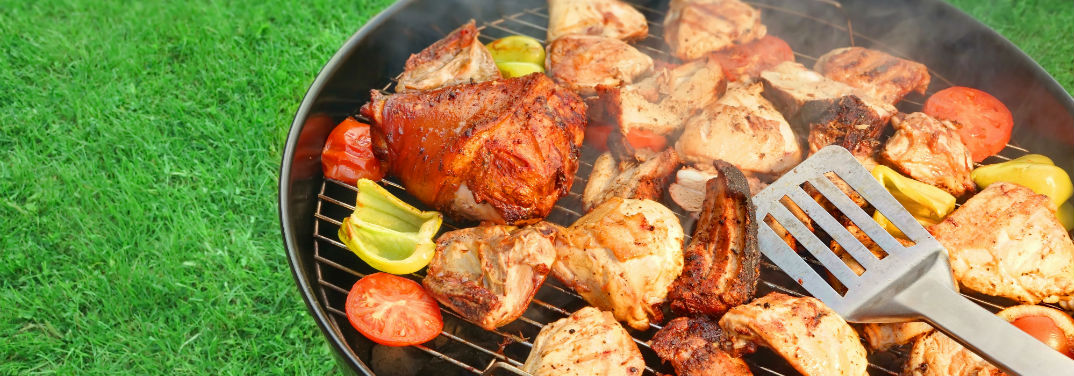 Tips for the Perfect Summer Cookout with image of grill filled with meat