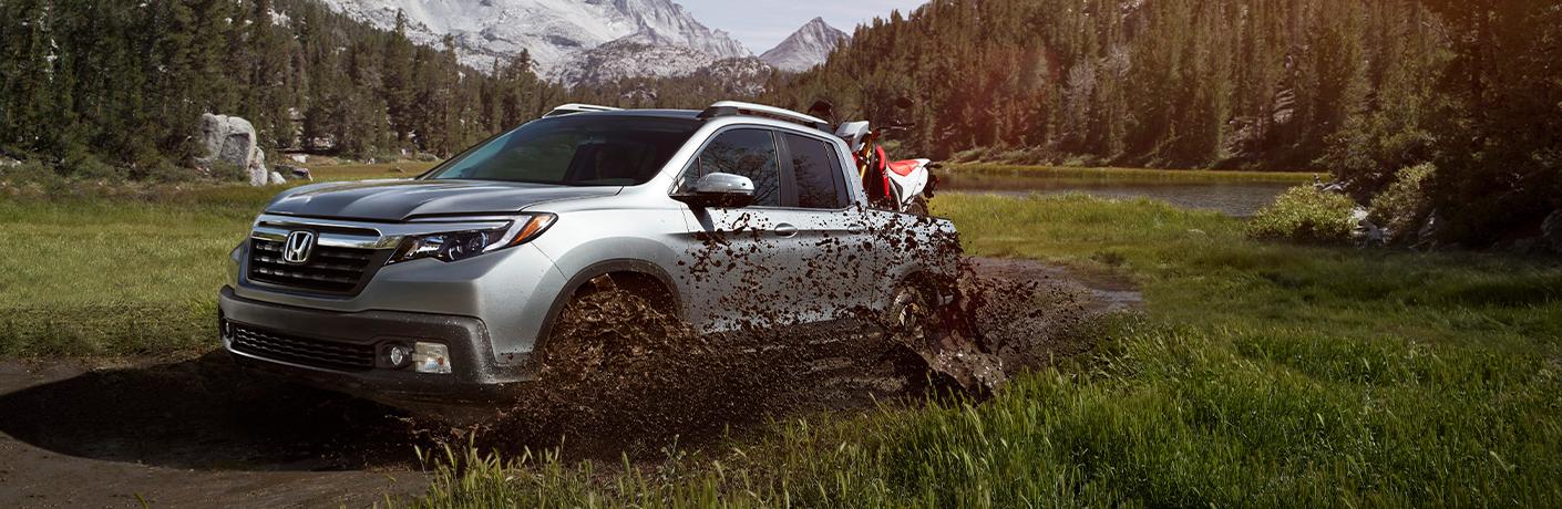 2020 Honda Ridgeline splashing through mud