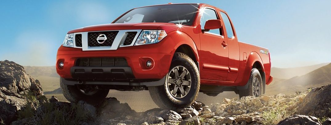2016 nissan frontier off roading lava red large