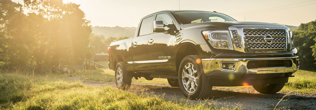2019 Nissan Titan XD exterior front fascia and passenger side in grassy field