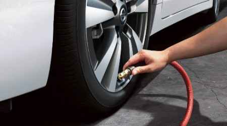 Person Filling Tire with Air