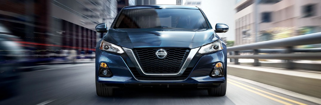2020 Nissan Altima driving down the city street