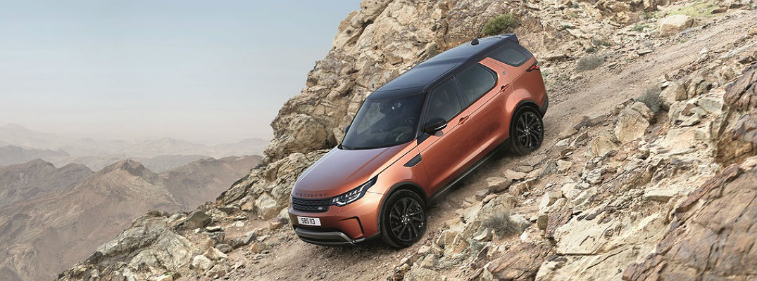 2018 Land Rover Discovery driving down mountain