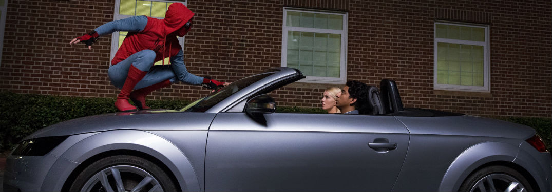 Spider-Man and a couple in an Audi