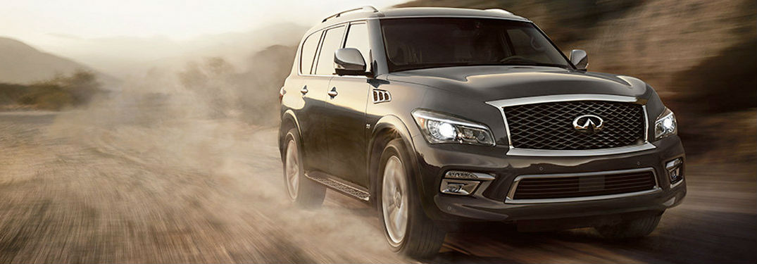 ... 2017 INFINITI QX80 Model Driving Down A Dirt Road